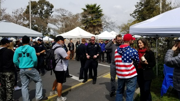 Pro-President Trump protesters speak with Oakland Mayor Libby Schaaf Sunday, March 18, 2018 at the Temescal farmers market in the 5300 block of Claremont Avenue.