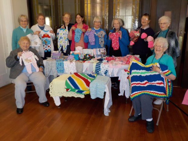 "Priscilla Circle ""Grandmas"" of the Martinez Congregational Church donateditems at their 20th Annual Baby Shower on behalf of the Newborn Infant Project at Contra Costa Regional Medical Center in Martinez, including, from left, Bev Annis, left, Carol Partridge, Marlene Thompson, Shirley Peterson, Teresa Benson, Edie Porter, Jacquie Ulrich, Nancy Hobert, Betty Holt and Bertha Peters. Courtesy Martinez Congregational Church"