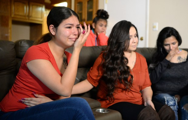 """Evelina Mondragon, 18, the sister of Elena """"Ebbie"""" Mondragon, who was killed by Fremont Police, is comforted by her aunt Christina Flores, during a press conference announcing a lawsuit against the Fremont Police Department in Antioch, Calif., on Tuesday, March 13, 2018. Ebbie was killed when police investigating an armed robbery, fired on the vehicle she was in as it tried to escape on March 14, 2017. Attorney John Burris announced that they will sue Fremont Police Department on behalf of the Mondragon family. (Doug Duran/Bay Area News Group)"""