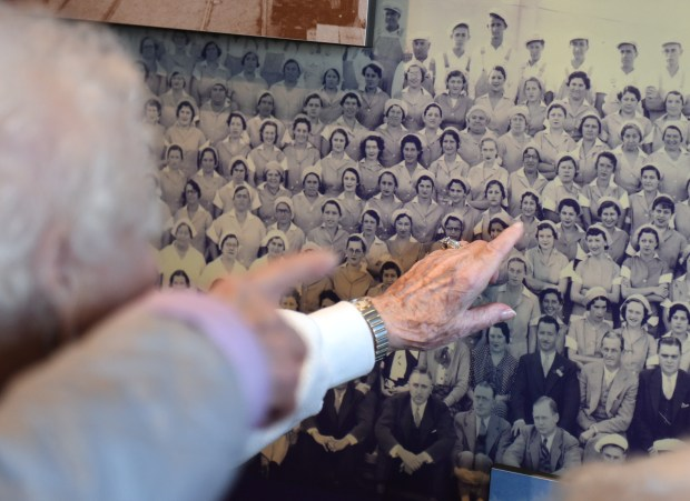 Josephine Lico, 103, points out her friend, Stella Bruno, in a group photo from the Felice and Perrelli Canning Company at the National Rosie the Riveter Day Celebration on March 21 at the Rosie the Riveter Visitor Education Center in Richmond, California. Lico said that back in 1933 when the photo was taken, everyone was happy when the cannery opened because there weren't many places to work in Richmond. Most of her friends and relatives ended up working there. Most of the canned fruit was sent overseas to feed soldiers in World War II. (Courtesy of Haley Nelson)