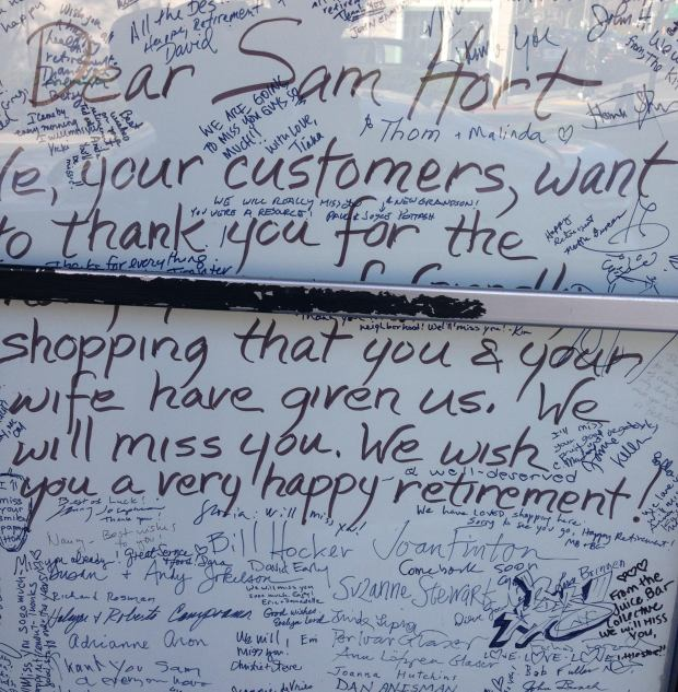 A large number of signatures from customers cover a large sign in response to the closure of The Produce Center on Shattuck Avenue in Berkeley. (Martin Snapp/For Bay Area News Group)