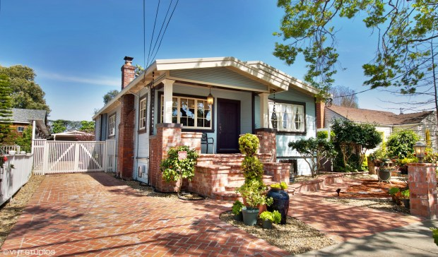This bungalow home and the separate cottage each come with their own inviting yards and laundry room/closets.