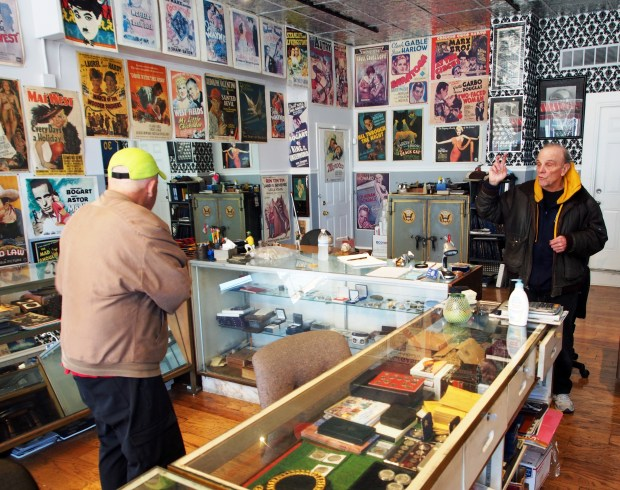 Chris Treadway/for Bay Area News GroupLarry Bovo, right, the proprietor of longtime Alameda collectibles shop The Silver Baron, talks coins with a customer at his relocated shop that moved last year to Webster Street.