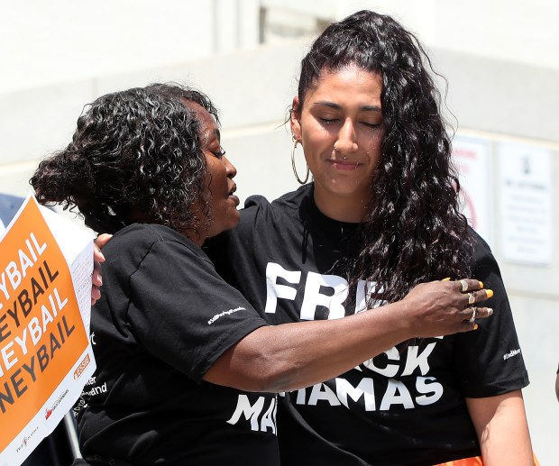 """Cheryl Diston, left, gets a hug from Adlemy Garcia during the """"Black Mamas Bailout"""" rally on the steps of the Rene C. Davidson Courthouse on Thursday, May 10, 2018, in Oakland, Calif. (Aric Crabb/Bay Area News Group)"""