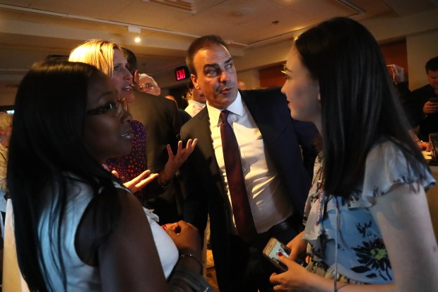 Contra Costa County District Attorney candidate Paul Graves, center, visits with supporter Holly Tillman, left, his wife Jennifer Graves, second from left, and daughter Camden Graves, right, during and election night party on Tuesday, June 5, 2018, in Pleasant Hill, Calif. (Aric Crabb/Bay Area News Group)