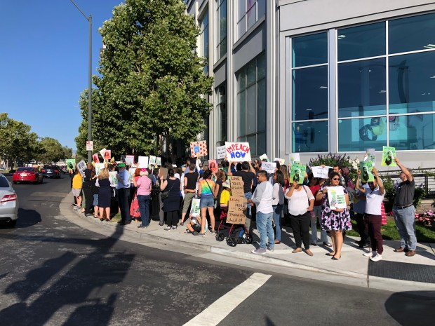 About 70 protesters on each corner of Stevens Creek and Winchester boulevards in San Jose lined up early Tuesday evening to show their displeasure of the Supreme Court ruling upholding President Donald Trump's travel ban policy. (Anna-Sofia Lesiv/Staff)