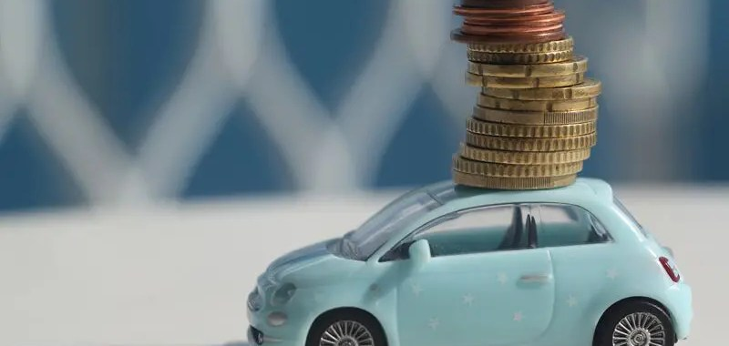 toy car with coins stacked on top of it