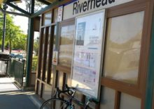 A bicycle studies the North Fork train line at the Riverhead station.