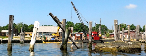 Dock workers replace the bulkhead at the New Suffolk Waterfront marina last summer