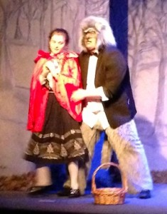 Little Red Riding Hood (Ella Watts) gets a visit from the Big Bad Wolf (Devin Lilly).