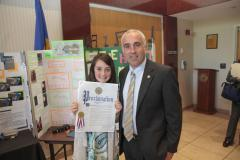 Montauk student Kendall Stedman receives a proclamation from Jay Schneiderman