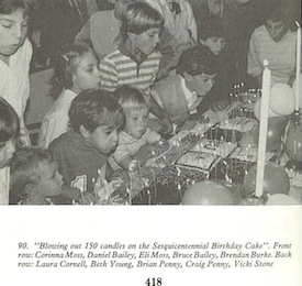 Blowing out the candles at the church's 150th birthday. I'm the girl in the second row at left.