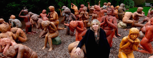 """South Fork Sculptor Sarah Lowenstein with her sculpture, """"Dark Elegy,"""" of family members of the victims of Pan Am 103"""