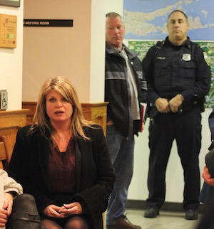 Councilwoman Jodi Giglio addressed the crowd, while the police looked on.
