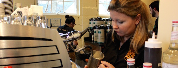 Co-owner Theresa Belkin steams milk for a cappuccino Sunday morning.