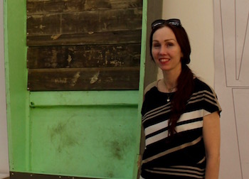 "Andrea Grover with a recent installation from the Parrish exhibit ""Radical Seafaring,"" which she curated."
