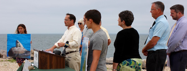 Environmentalists gathered at Orient Point Friday to announce their lawsuit against the federal government over the proposed sale of Plum Island