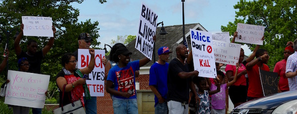 Sunday's protest on Peconic Avenue in Riverhead.