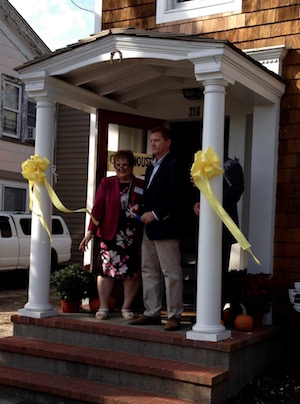 Community Action Southold Town Executive Director Linda Ruland and Southold Town Supervisor Scott Russell cut the ribbon at CAST's new office at 316 Front Street in Greenport Sunday afternoon. | George Cork Maul photo
