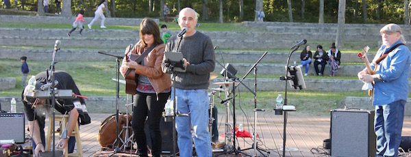 """Southampton Town Supervisor Jay Schneiderman (center) and the Jan Hanna band inaugurated the new Good Ground Park in Hampton Bays Saturday afternoon. """"This is your park,"""" said Mr. Schneiderman of the 36-acre public space, which includes an amphitheater where the town envisions live concerts and theatrical productions in the future."""
