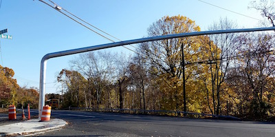 Poles for the new traffic signal at Longneck Boulevard