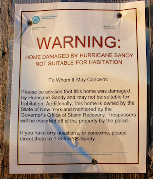Signs warns would-be squatters that the houses are not safe for habitation.