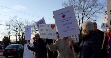 Supporters of the Affordable Care Act rallied outside of Peconic Bay Medical Center Thursday evening.