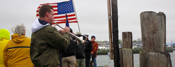 Matt Swain played Taps at Greenport's Memorial Day service at the Railroad Dock Monday morning.
