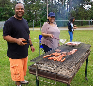 Victor Hickson and Colleen Brown keep the grill going.