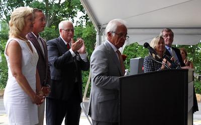 John Kanas spoke of the partnership that lead to the new construction, while Elaine Kanas and John Kanas Jr. looked on.