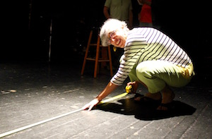 "Kathy Kafer of ""Leaving Evelyn"" measures the stage at the Vail-Leavitt Music Hall."