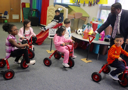 Trying out the tricycles.