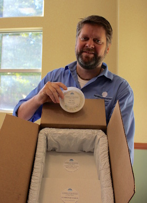 Peter Haskell of Haskell's Seafood with his tuna salad and the packaging used to ship fish to peoples' homes.