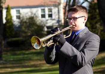 Joseph Stuckart of Mattituck High School plays Taps at the Mattituck American Legion's Veterans Day service.