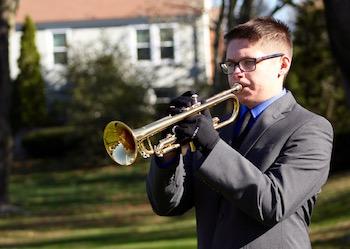 Joseph Stuckart of Mattituck High School plays Taps at the Mattituck American Legion's Veterans Day service.