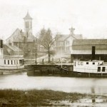 The Peconic Riverfront in the 1890s. The Congregational Church in the background is still standing today.