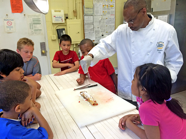 Chef Doug Gee in the kitchen at the Bridgehampton Child Care & Recreation Center
