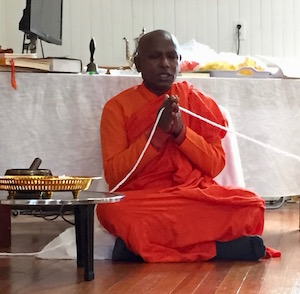 Venerable Bhante Kottawa Nanda leads the group in prayer.