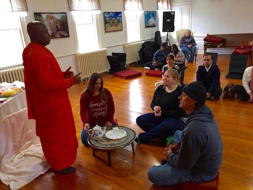 Mr. Nanda, Indra Lahiri, Johnny Braz and Sarah Thornton prepare a blessing