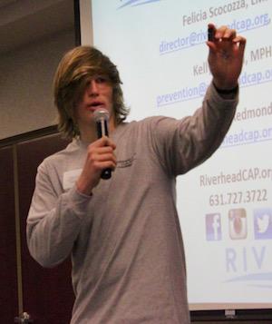 Matt LaCombe shows parents how e-cigarettes are used.