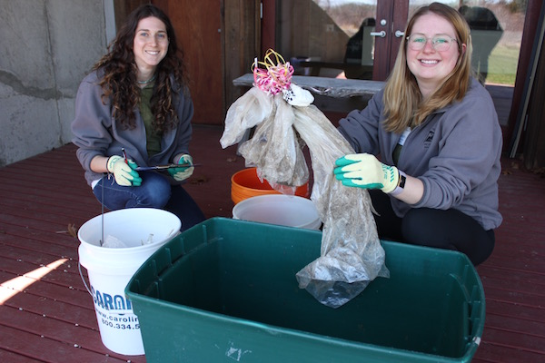 SoFo Environmental Educators Ashley Federici and Xylia Serafy sort beach trash after a cleanup