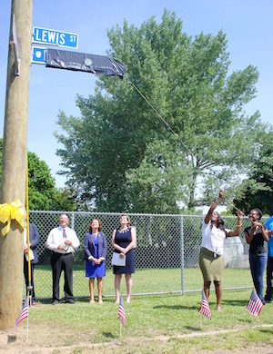 Dashan Briggs' sisters, Heather and Daja Young, unveiled the new street sign.