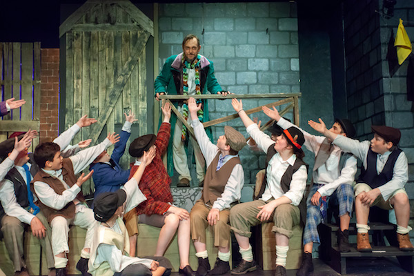 "Fagin's gang salutes their ringleader in NFCT's production of ""Oliver!"" 