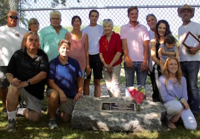 Relatives of New Suffolk volunteer, father, fireman and school board member Jason Cooper, who died in an accident last year, gathered Thursday to dedicate the New Suffolk Ball Field to Mr. Cooper.