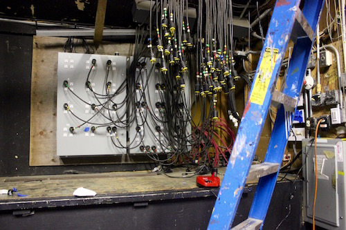 The lighting panel, a series of outlets, was built by theater volunteers in 1990.