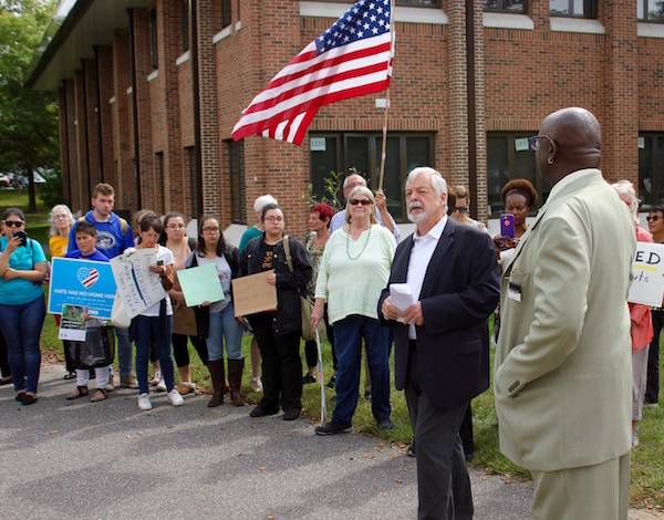 Southampton Councilman John Bouvier gave his account of the meeting to the crowd.