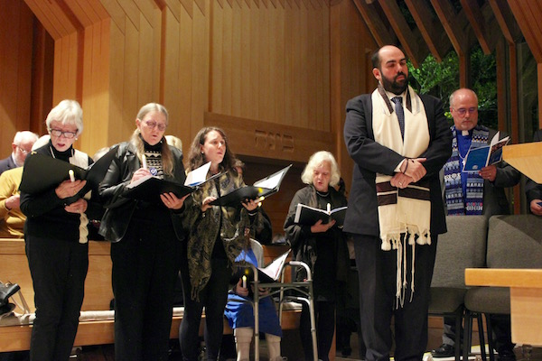 """The chorus sings a new composition, """"Tree of Life,"""" for the victims of the shooting in Pittsburgh."""