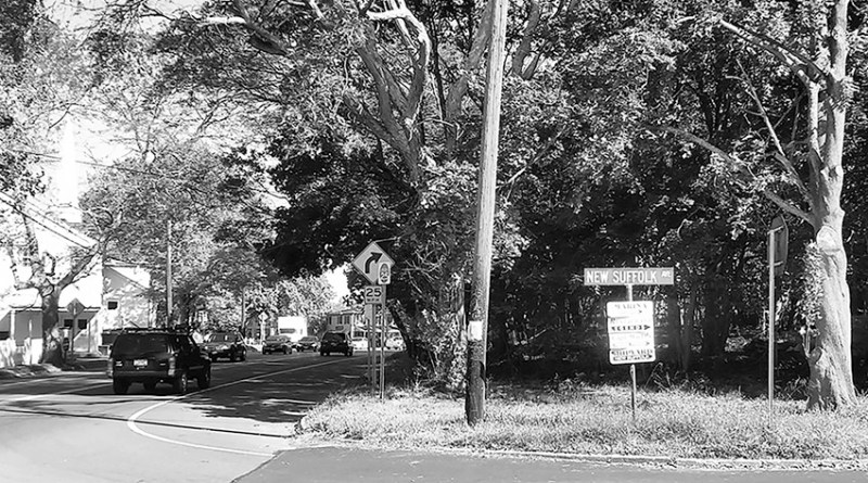 The corner of the Main Road and New Suffolk Avenue, where residents fear a large hardware store could dramatically alter the neighborhood.