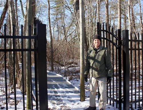 Quogue Wildlife Refuge Executive Director Mike Nelson at the new gate to the Fairy Dell in mid-February.