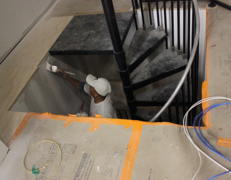putting the finishing touches on a spiral staircase to access stage left